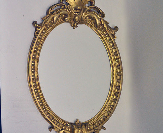 Lot 208: Turn cent Louis XVI gold leaf richly ornated oval mirror. H46cm.