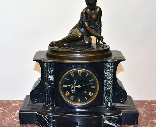 Lot 217: 19th c Nap.lll black marble mantle clock with bronze statue of kneeling girl with ball game. H39xW36cm.