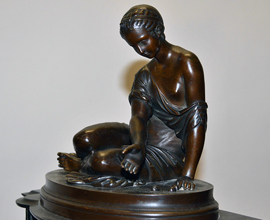 Lot 217_1: 19th c Nap.lll black marble mantle clock with bronze statue of kneeling girl with ball game. H39xW36cm.