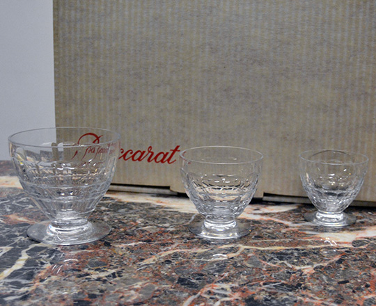 Lot 222: Three sets of various size Baccarat crystal glasses with original boxes.