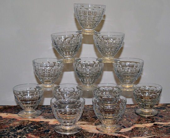 Lot 222_1: Three sets of various size Baccarat crystal glasses with original boxes.