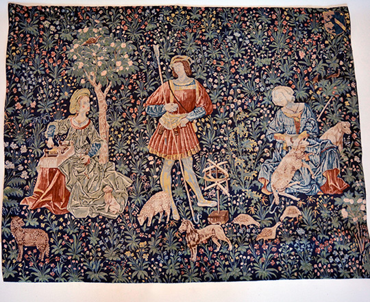 Lot 238: Turn cent tapestry with animated medieval scene on abundant floral back ground. H122 x W152cm