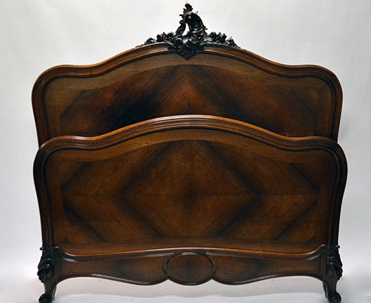Lot 240: 19th cent Naplll, Louis XV  rosewood double bed with richly sculpted pediment. Max W145cm.