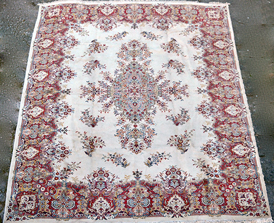 Lot 247: Large oriental wool carpet; 460 x 340cm.