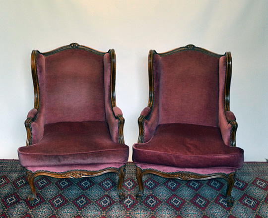 Lot 270: Large pair Louis XV style red velvet covered bergeres with 'ears' wing sides.