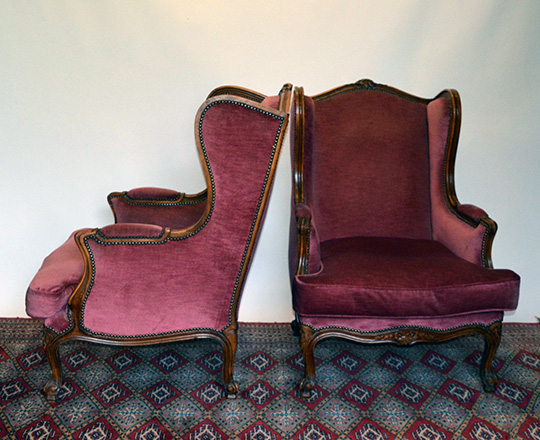 Lot 270_1: Large pair Louis XV style red velvet covered bergeres with 'ears' wing sides.