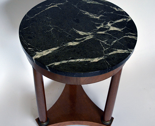 Lot 278_1: Empire style dark green veined marble top on a three column base H71 x dia.50cm.