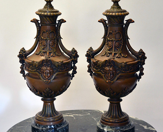 Lot 279: Large pair bronze wash spelter lidded vases on a green marble base. H45cm.