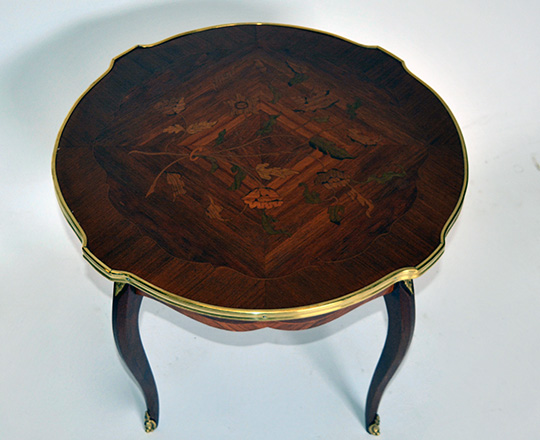 Lot 281_1:  Round Louis XV low center table with floral marquetry top and brass skirt. H50 x dia.61cm.