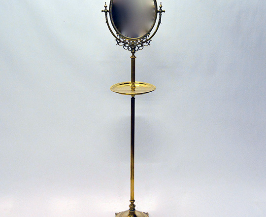 Lot 286: Turn cent? Gilt bronze/brass barber stand with tilt oval mirror. H 159cm.