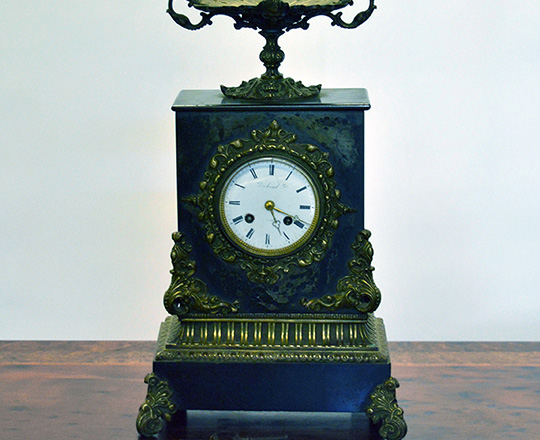 Lot 287: Early 19th c Restauration period black marble mantel clock with gilt bronze ornaments. H33x W22cm.