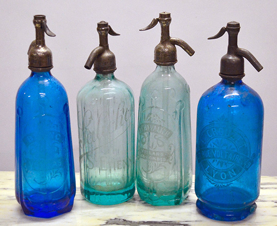 Lot 371: Four 19th cent blue colored soda bottles. Max H32cm.