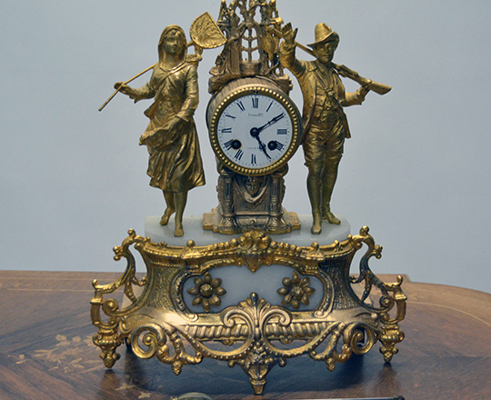 Lot 373: 19th cent gilt spelter mantle clock with couple. H42cm.