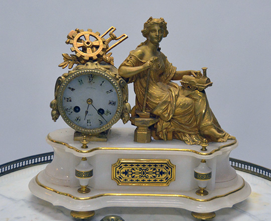 Lot 377: Turn cent gilt spelter and alabaster mantle clock with woman representing ''Industry''. H30xW36cm.