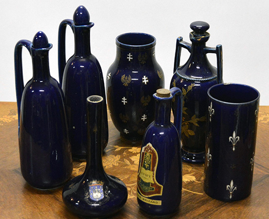 Lot 379: Various 19th cent cobalt blue ceramique bottles, vases, amphor, ect. Max H30cm.
