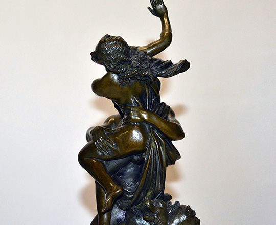 Lot 386_3: Dark medal color bronze statue of woman captured by faun. H 38 cm.