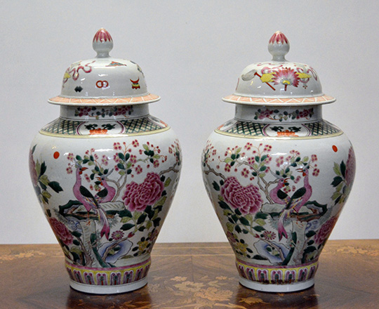Lot 388: Pair early?cent lidded Chinese Rose family vases with floral and animal scenes. H37cm. (knob rep.)
