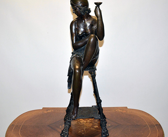 Lot 389: Large bronze sculpter of (1920's Oriental?) woman on a stool with a cup. H 82cm.