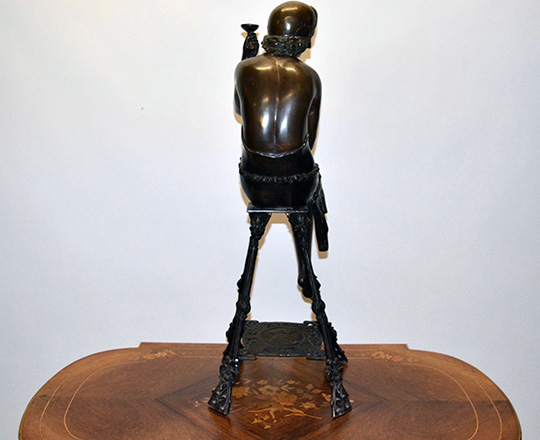 Lot 389_2: Large bronze sculpter of (1920's Oriental?) woman on a stool with a cup. H 82cm.