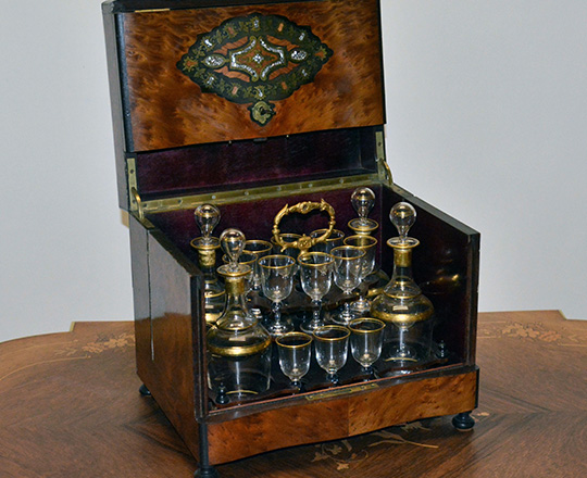 Lot 395: Beautiful 19th c Nap.lll liquor cabinet with fine marquetry and extactable glass service set, one glass missing.