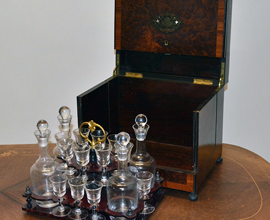 Lot 396_1: Beautiful 19th c Nap.lll liquor cabinet with fine marquetry and extactable glass service set, some glass repaired.