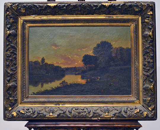 Lot 398: Oil on canvas with river in country landscape at dusk in a gilt gesso frame. Tot. H63 x W81cm.