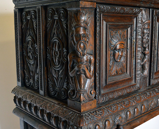 Lot 405_2: 17th cent well restored two stage oak cabinet on a console base with finely carved faces on top section. H139xW101xD57cm.