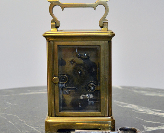 Lot 422_1: 19th cent bronze travel clock with alarm setting. H14,4xW8xD6,5cm.