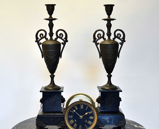 Lot 425: Pair Nap.lll candlesticks on a black marble base. H45cm.
