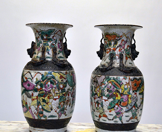 Lot 433: Pair 19th cent Chinese ceramic Nankin baluster vases with worrior scenes. H 36cm.