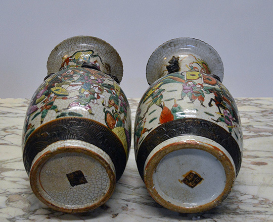 Lot 433_2: Pair 19th cent Chinese ceramic Nankin baluster vases with worrior scenes. H 36cm.