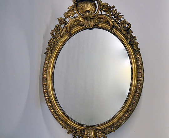 Lot 434: 19tn cent. Louis XV gilt oval mirror with rich ornated pediment (rep.) H100 x W69cm.