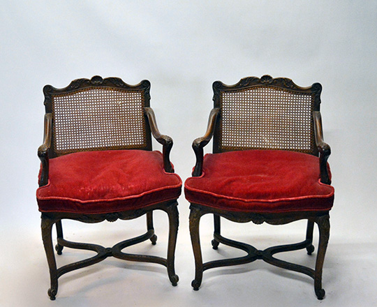 Lot 435: Pair 18th ? 19th cent caned Louis XV / Regence walnut armchairs with stretcher base.