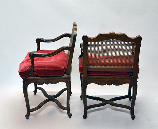 Lot 435_1: Pair 18th ? 19th cent caned Louis XV / Regence walnut armchairs with stretcher base.