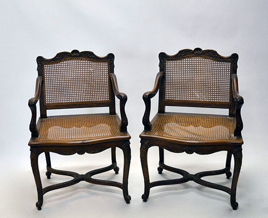 Lot 435_2: Pair 18th ? 19th cent caned Louis XV / Regence walnut armchairs with stretcher base.