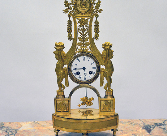 Lot 447: Very fine quality 18th -19th c. gilt ciseled bronze Directoire/Empire mantel clock. H46cm.