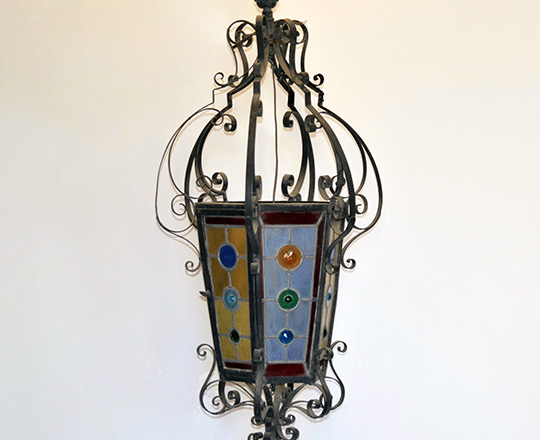 Lot 452: Large 19th cent. Iron lantern with colored stained glass. H100cm