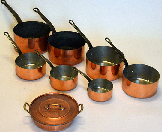 Lot 456: Set of seven + one copper pots of which one lidded. max.dia.22cm.