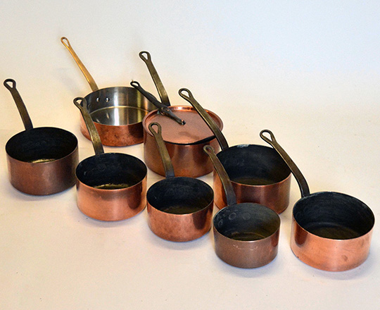 Lot 485: Set of seven + one copper pots of which one lidded. max.dia.22cm.