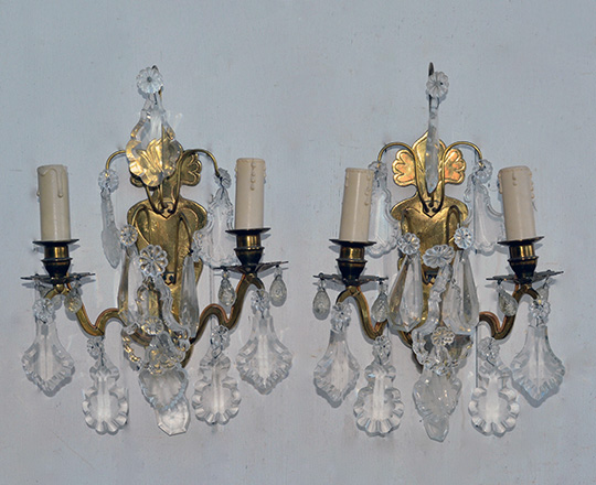 Lot 488: Pair early cent gilt brass, crystal two light wall sconces. H 36cm.