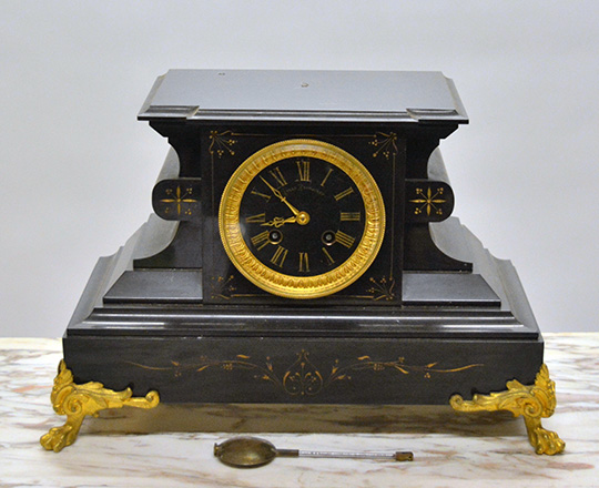 Lot 490: 19th c Nap.lll black marble mantle clock. H23,5 x W37cm.