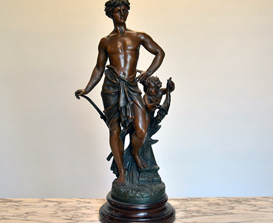 Lot 497: Turn cent bronze wash spelter statue of man representing 'Agriculture'. H62cm