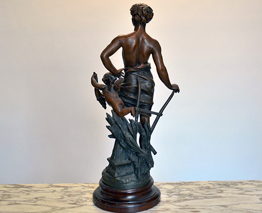 Lot 497_1: Turn cent bronze wash spelter statue of man representing 'Agriculture'. H62cm