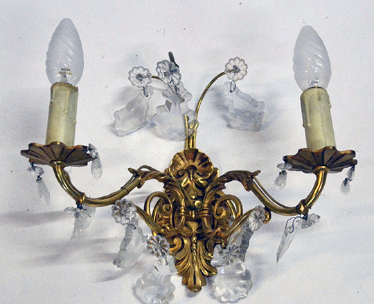 Lot 519_1: Pair gilt bronze two light crystal wall sconces. H25 x W30cm.