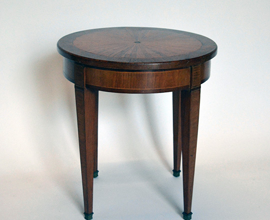 Lot 520:  Small Louis XVI rose wood sun burst marquetry top round table. H48,5 x dia.45cm.