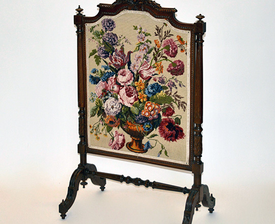 Lot 521: Turn cent Louis XVI fire screen with fine needle point floral decor. H109 x W63cm.