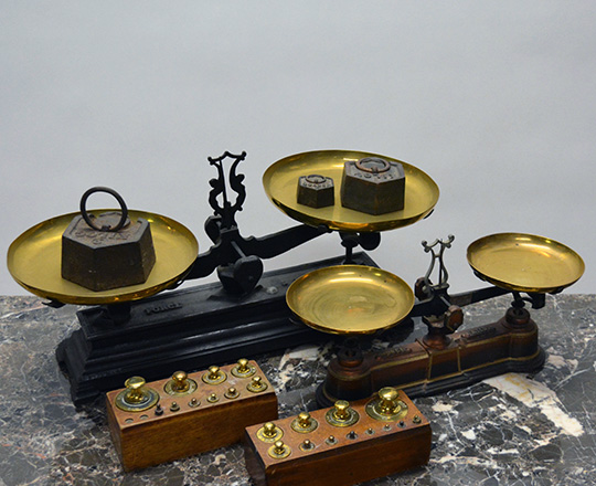 Lot 530: Two 19th cent scales withtwo sets of bronze weights in original casing plus three cast iron.