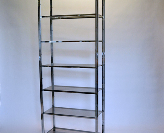 Lot 537: Seven smoked glass shelves chrome unit. H200xW80xD35cm.