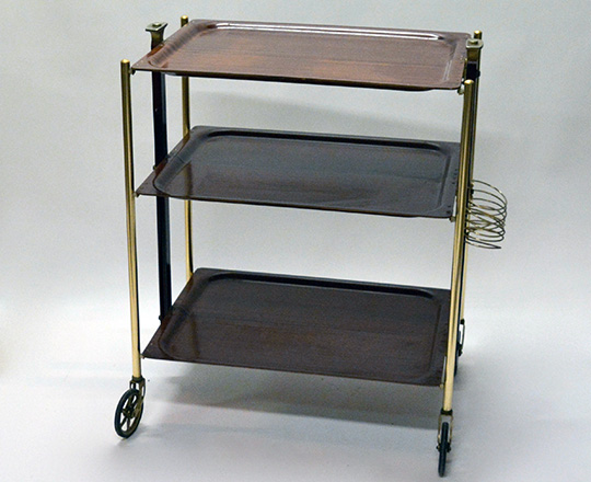Lot 538: 50's folding tray cart on wheels with three platters. W62 x D44cm (platter).