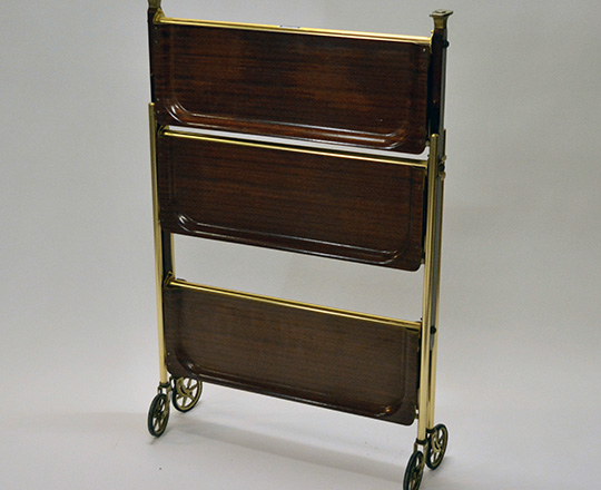 Lot 538_1: 50's folding tray cart on wheels with three platters. W62 x D44cm (platter).